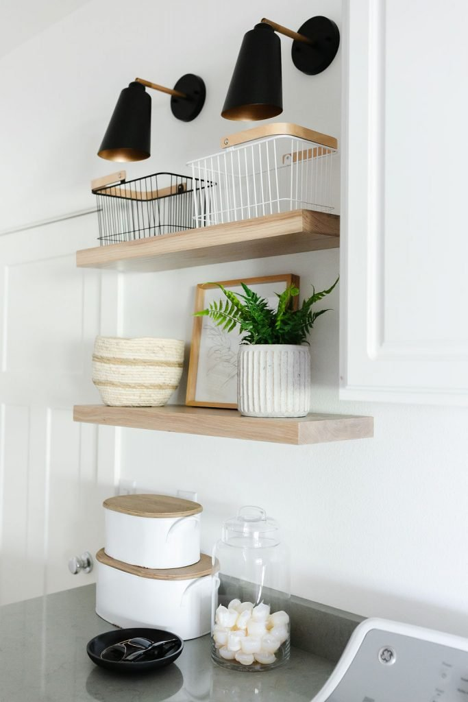 laundry room storage including baskets, bins and glass canisters