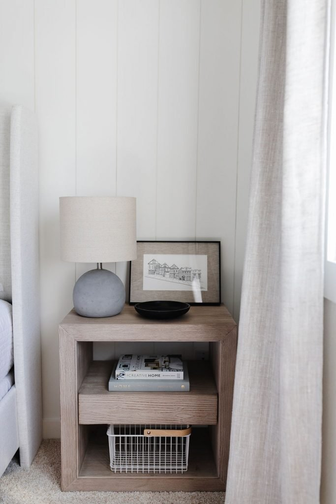 Early Black Friday Sales with Serena & Lily nightstand styled with an Amazon table lamp, McGee & Co. white wire basket and coffee table books.  A small McGee & Co black soapstone dish rounds out the styling.