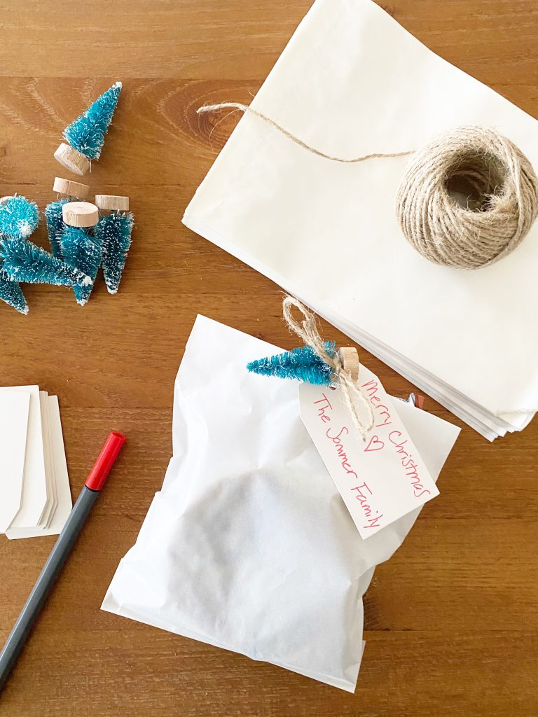 Holiday cookie as a small gift!  Place a few cookies inside a parchment bag, tie it with string, note and a cute tree!