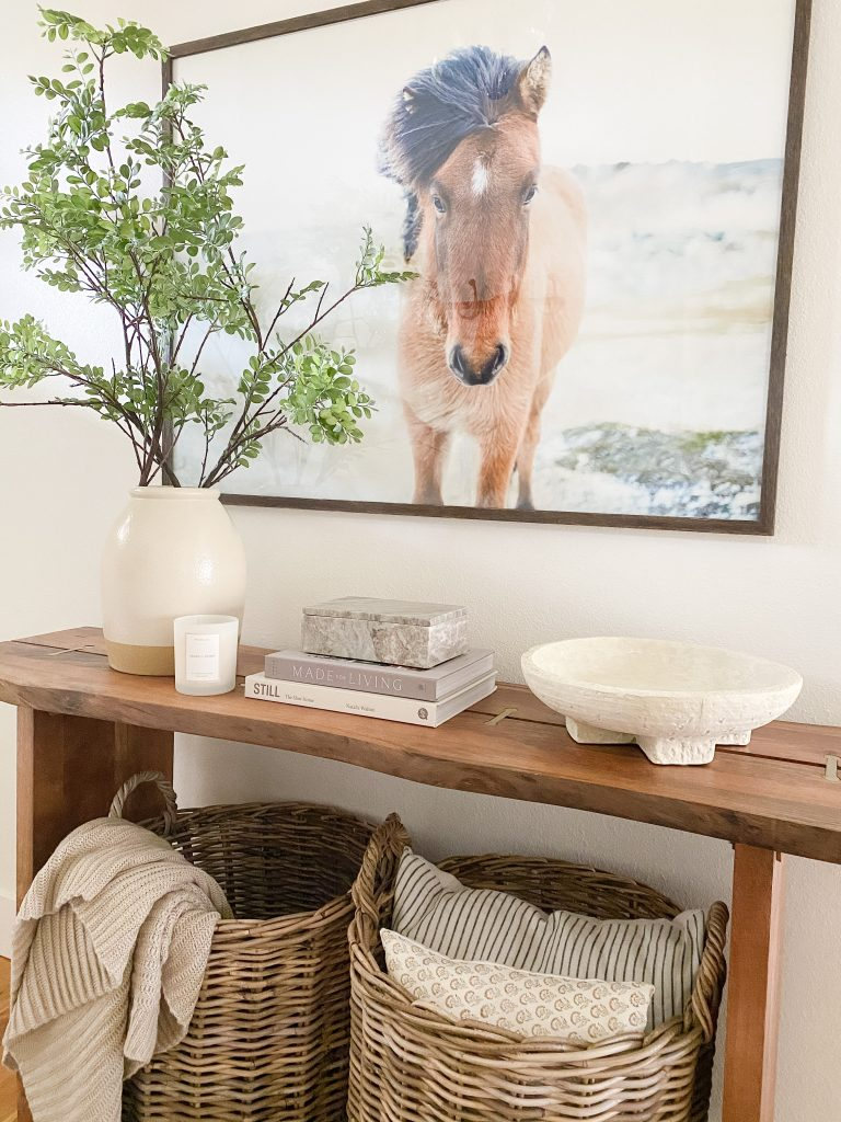 entryway baskets provide extra storage and serve as decor at the same time.