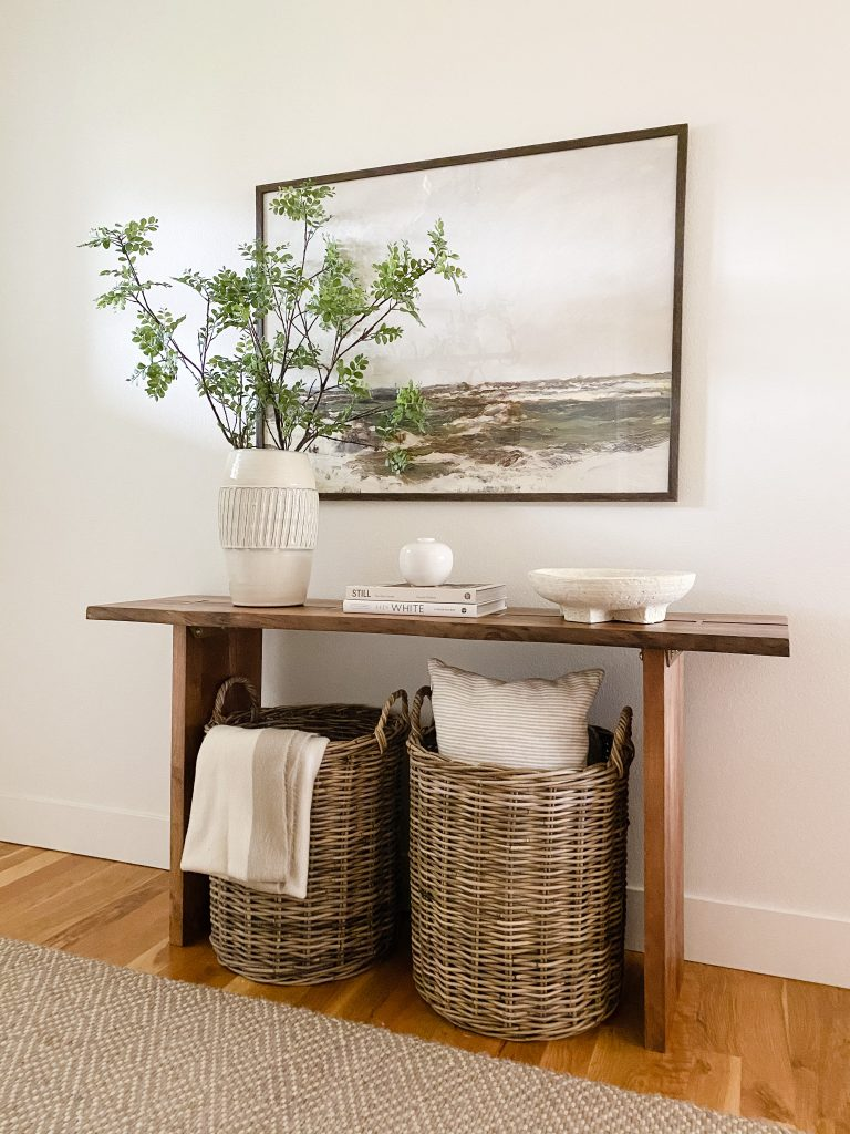oversized artwork above a console table