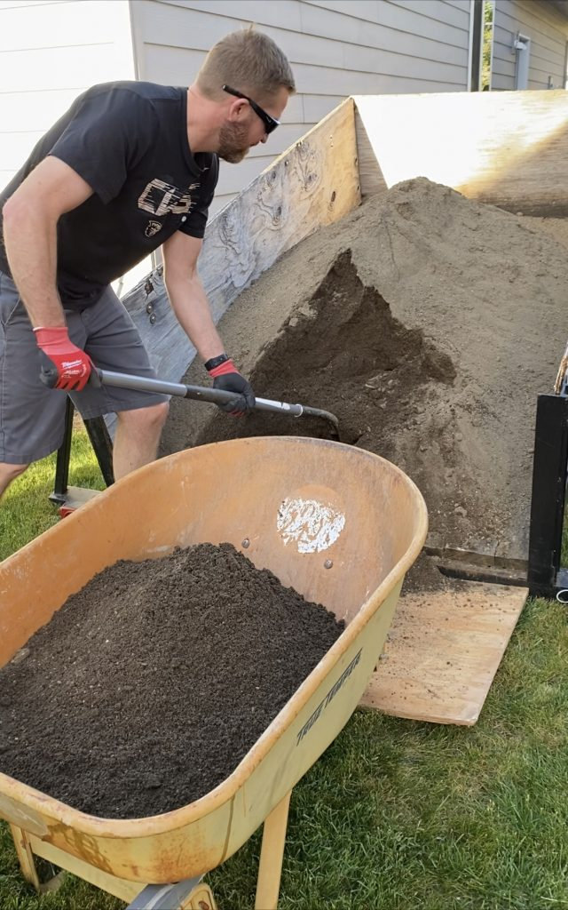 using sand to level the ground for a stock tank backyard pool