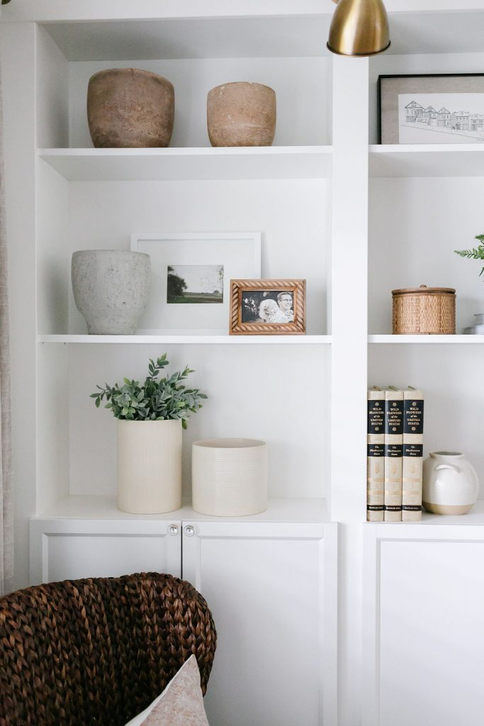 affordable shelf decor including vases, faux greenery and baskets