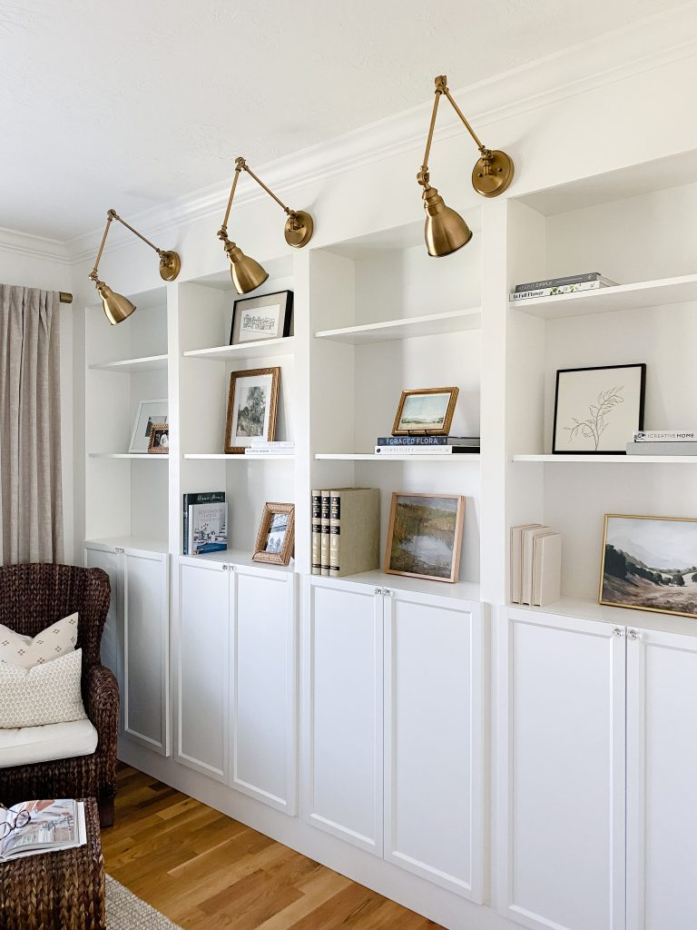 how to decorate your shelves step three is add in artwork and family photos
