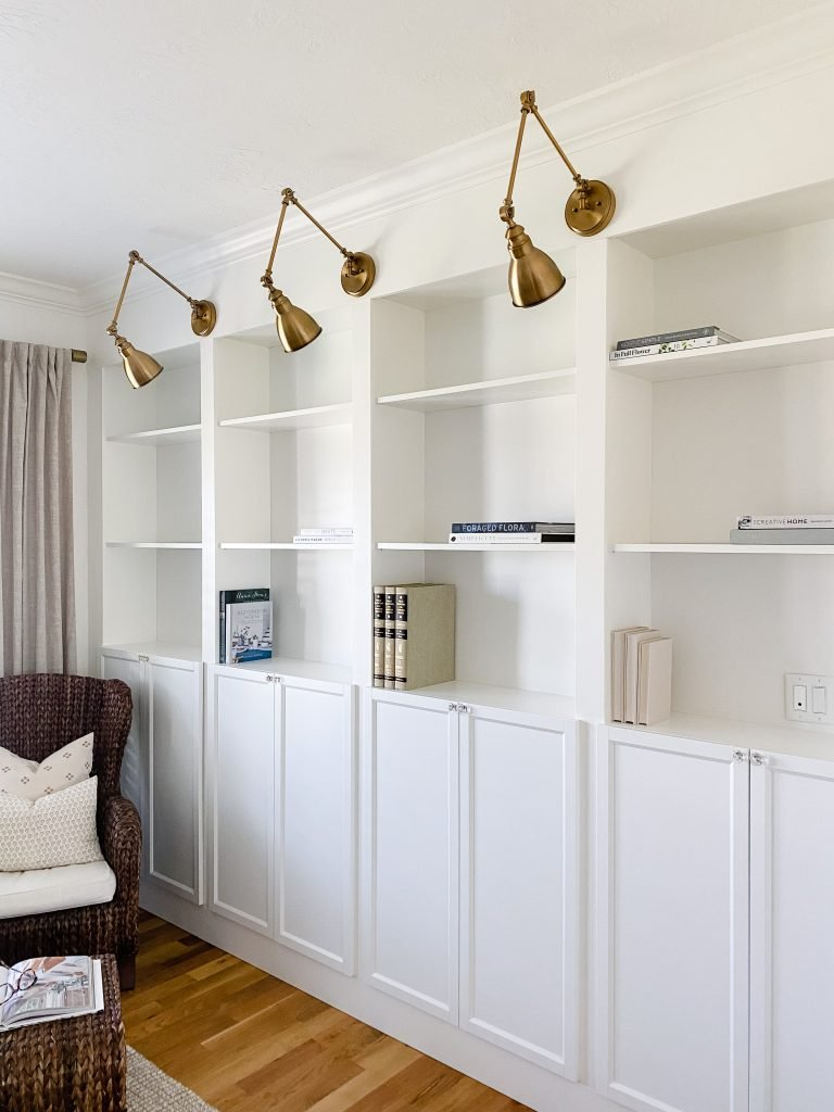 how to decorate your bookshelves step 2.  Start with books placed vertically and horizontally.