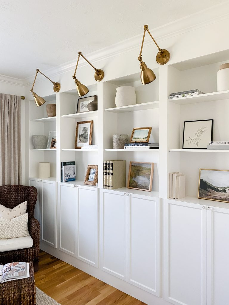 how to decorate shelves and bookcases using vases, books, pots, baskets, artwork, family photos