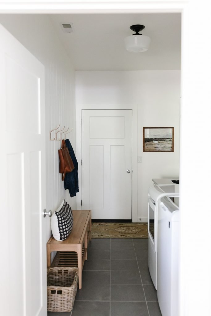 organize your home with pretty baskets in the mudroom