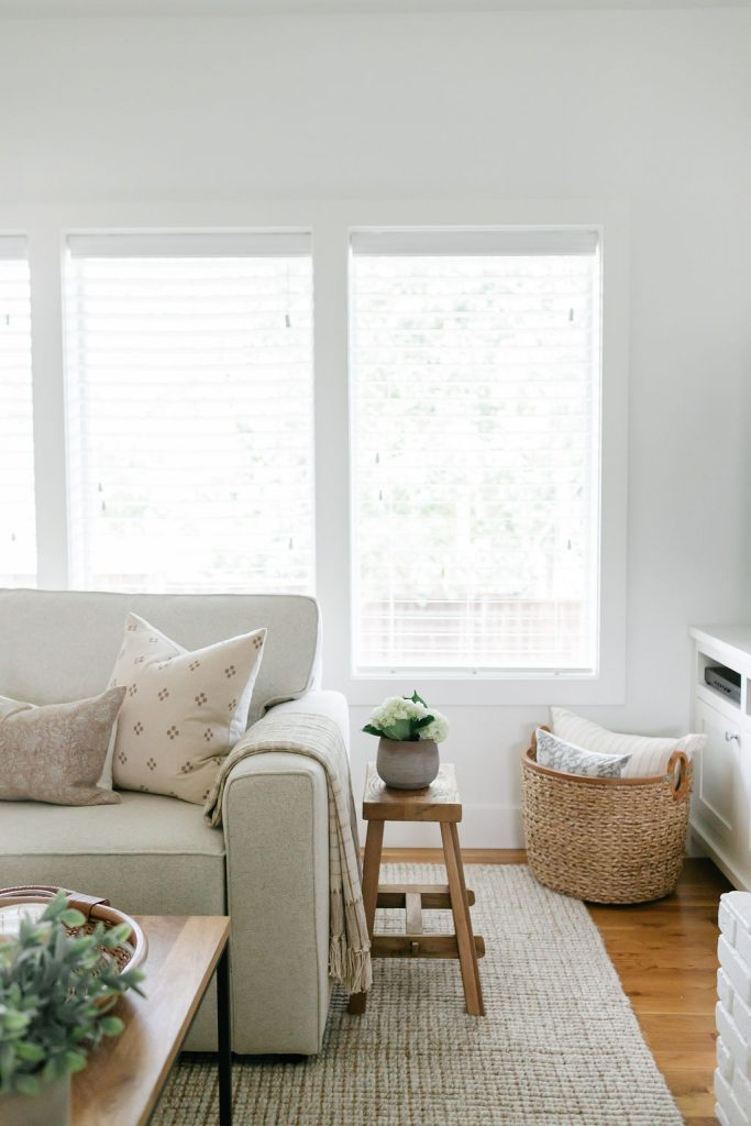 warm up a white room with baskets, pillows & throw blankets