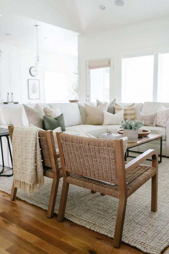 how to add warmth to an all white room with throw blankets